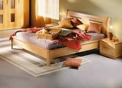 Деревянные кровати: преимущества и особенности