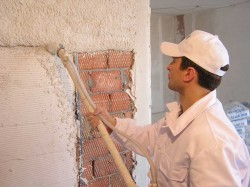 Как проводить оштукатуривание наружных стен