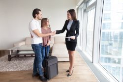 Travellers couple shaking hands with real estate agent, vacation